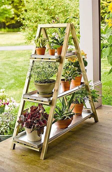Create extra space with a-frame ladder stands that elevate your fragrant and colorful plants.