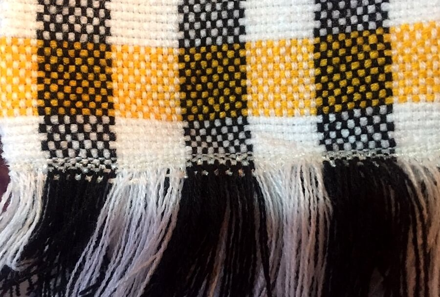 Many Moroccan wool blankets are reversible and feature knotted fringed ends.