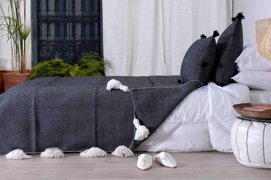 Pom pom pillows can compliment throws, blankets and bedspreads.