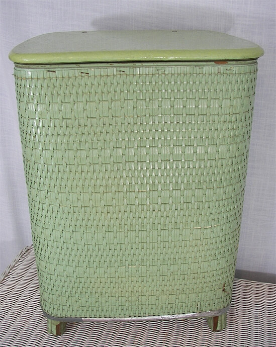 A wicker hamper can double as a side/end table with the added benefit of storage.