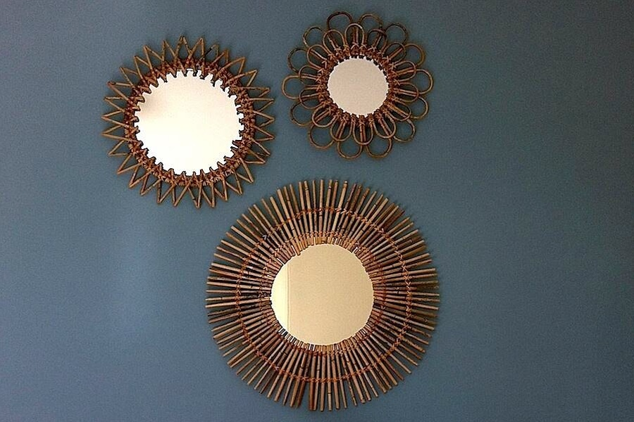 Multiple mirrors can make a splash on an otherwise drab wall.